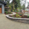 Landscaped Yard With Curved Paver Sidewalk & Retaining Wall